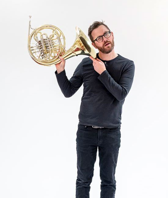 Craig Macdonald plays french horn for orchestra of the swan