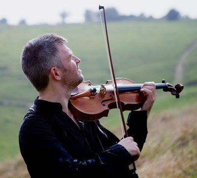 David Le Page Artistic Director for The Swan plays violin