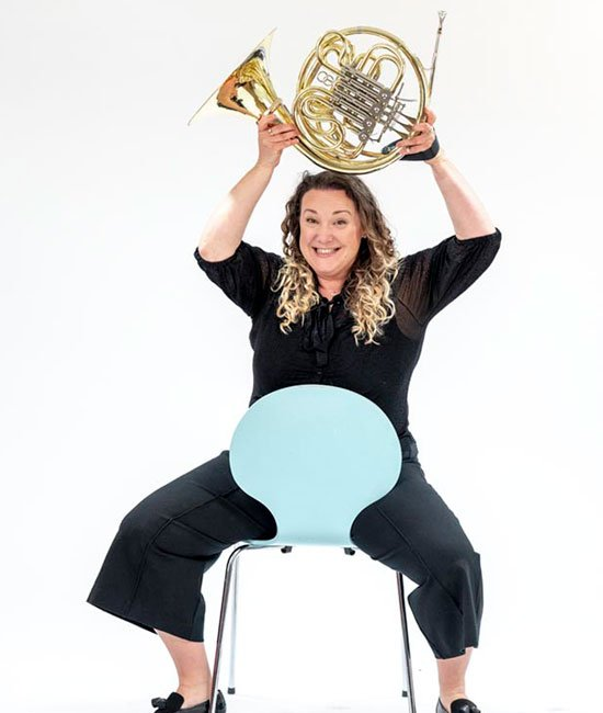 Francesca Moore Bridger plays french horn with orchestra of the swan